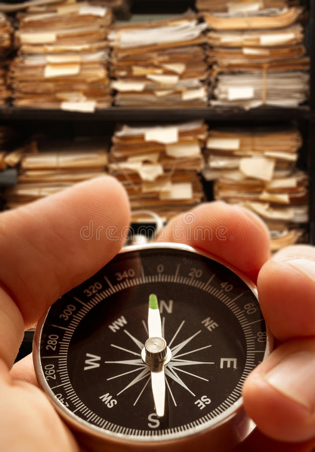 Hand with compass on paper documents royalty free stock images