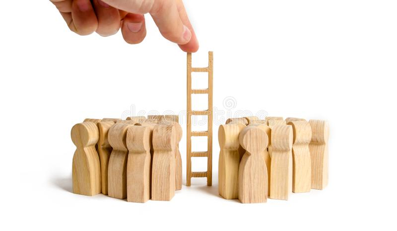 The hand stretches the ladder to two opposing groups of people. Support and resolution of conflict situations. Restraining. The parties and initiating the royalty free stock image