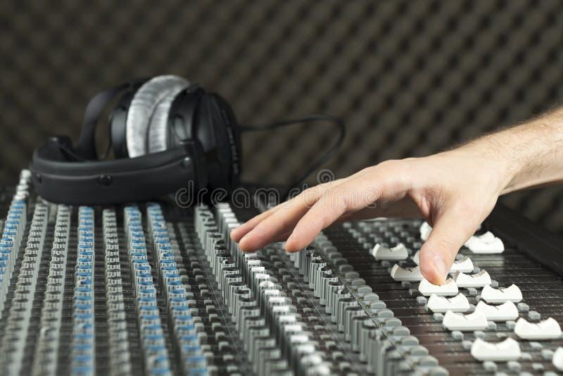 Hand on a studio mixer stock photos