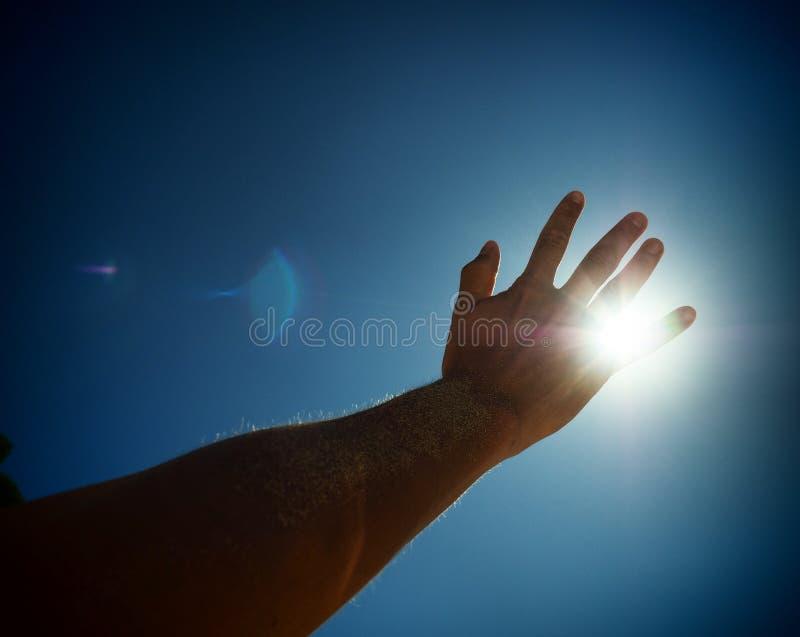 Hand in the sun stock photos