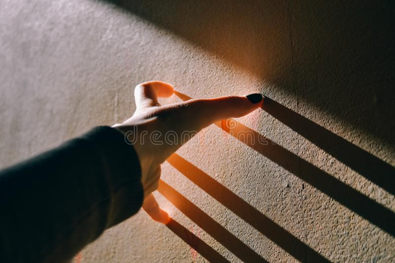 Hand in a sun rays royalty free stock image