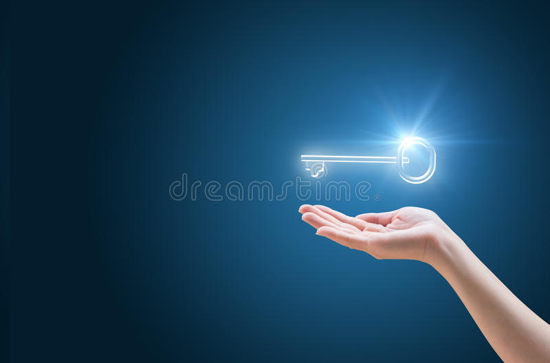 Hand supports the Key to success in business royalty free stock photo