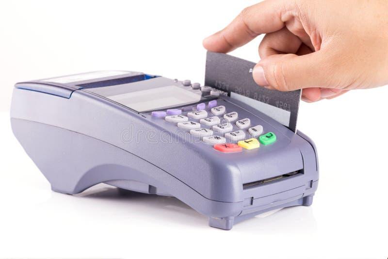 Hand Swiping Credit card. On Credit card Machine stock photos