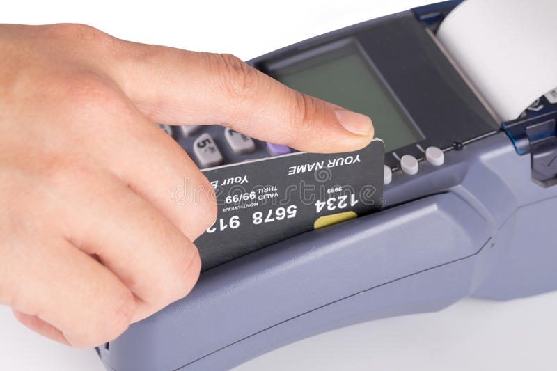 Hand Swiping Credit Card. On White stock photography