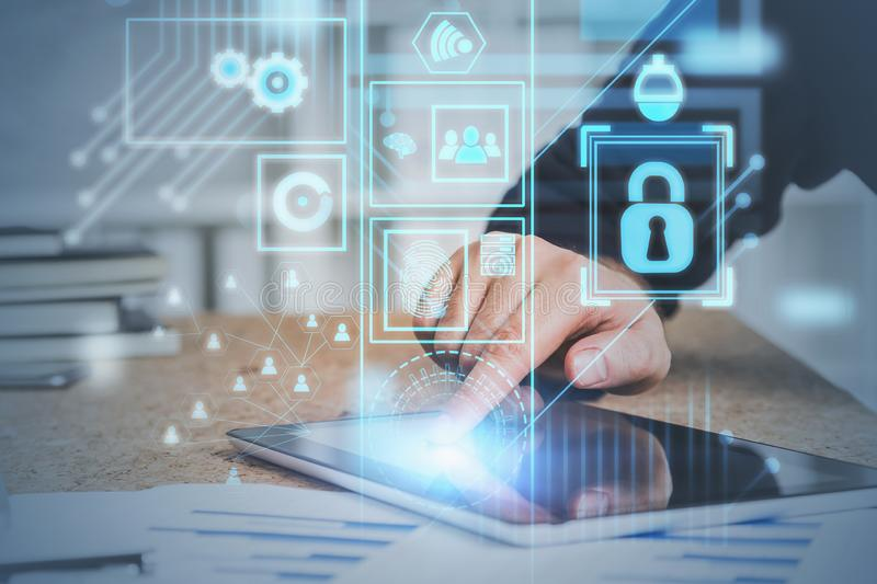 Hand on tablet screen, online security interface. Hand of man in suit using tablet computer in office with double exposure of online security interface and royalty free stock images