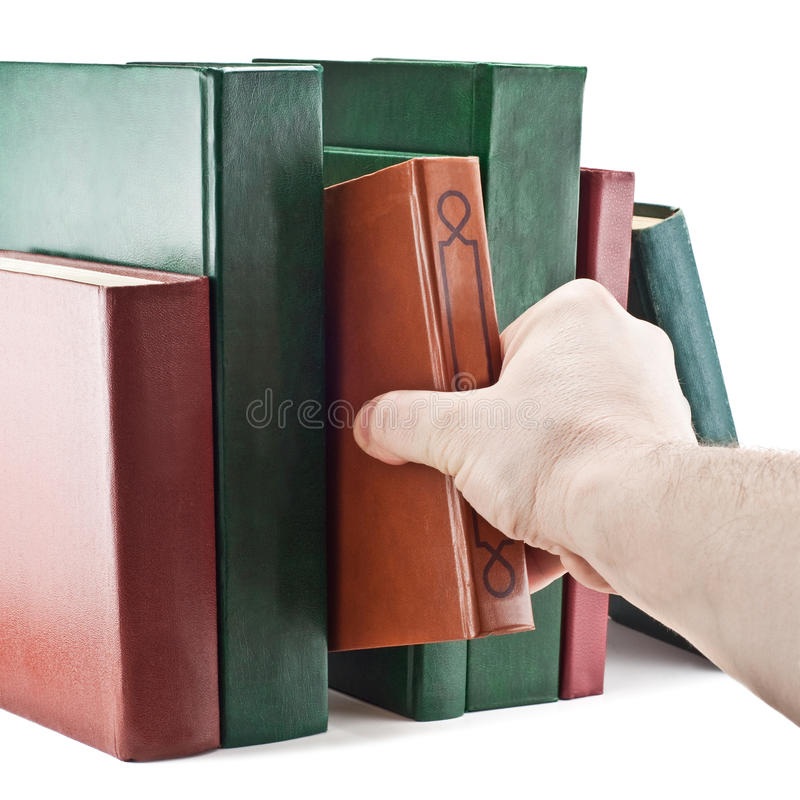 Hand taking a book. Isolated on white background stock images
