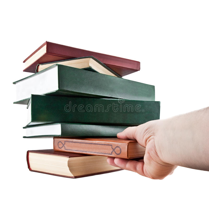 Hand taking a book. Isolated on white background royalty free stock image
