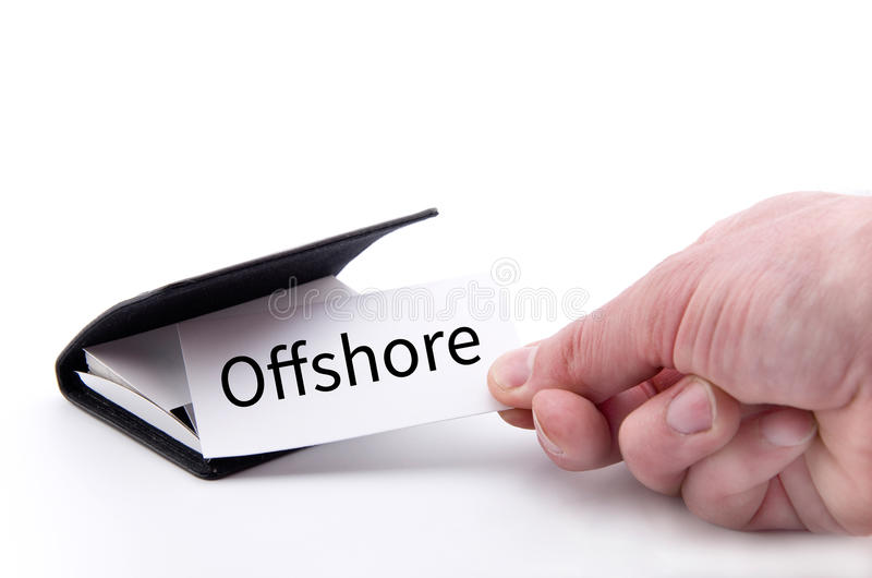 Hand taking a card with the word OFFSHORE royalty free stock photo