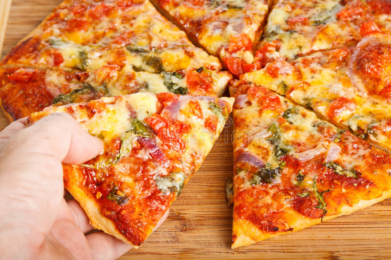 Hand Taking Homemade Pizza Royalty Free Stock Images