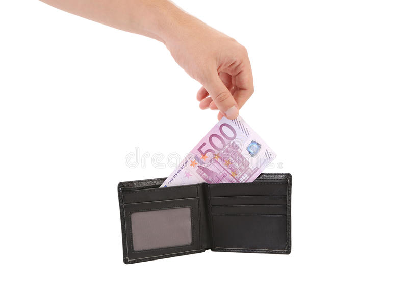 Hand taking out five hundred euro bill. royalty free stock photo