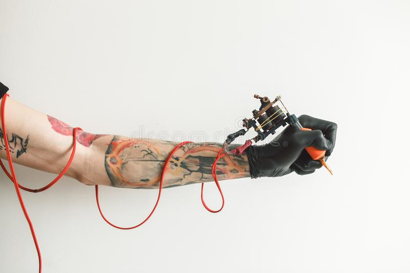 Hand tattoo artist with the tattoo machine royalty free stock photos