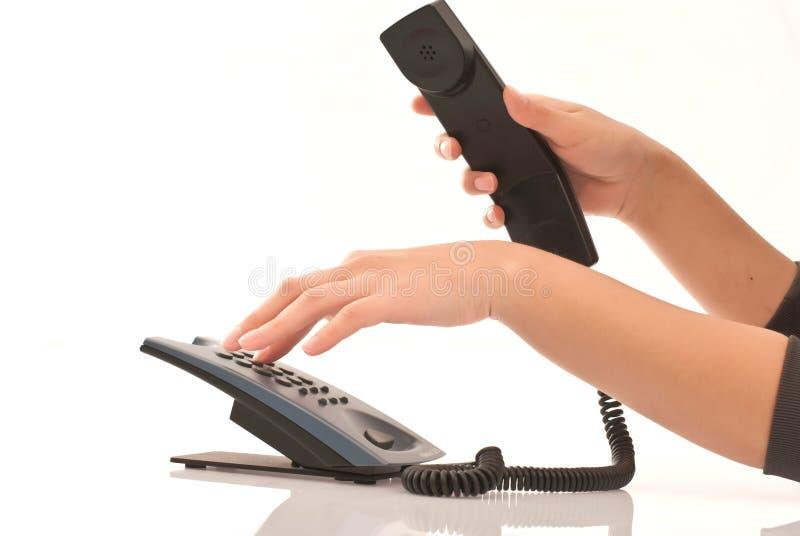 Hand am Telefon stockbild
