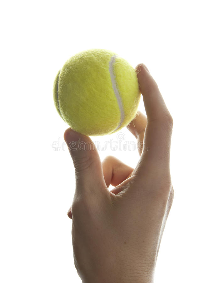 Hand and tennis ball stock image