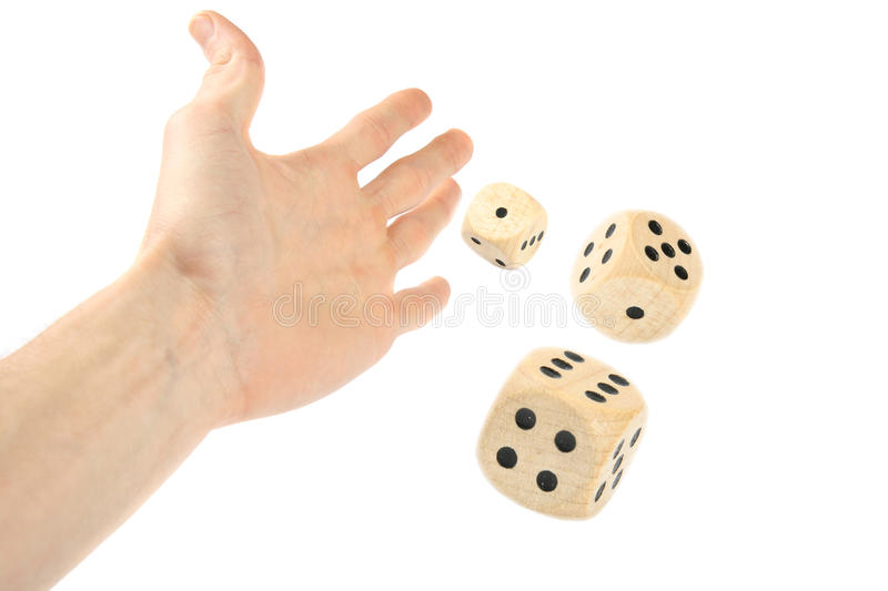 Hand throwing dice royalty free stock photos