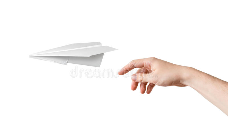 Hand is throwing origami paper airplane. Isolated on white royalty free stock photos