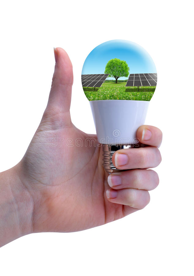 Hand with thumb up holding eco LED bulb with solar panel isolated on a white background. stock photos