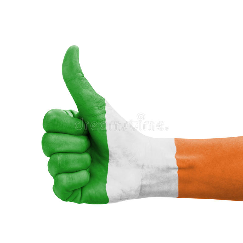 Hand with thumb up, Republic of Ireland flag paint. Ed as symbol of excellence, achievement, good - isolated on white background royalty free stock images