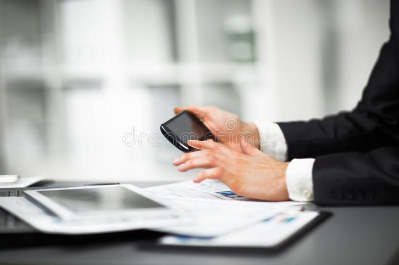 Download Hand to use a smartphone stock image. Image of image - 48995019