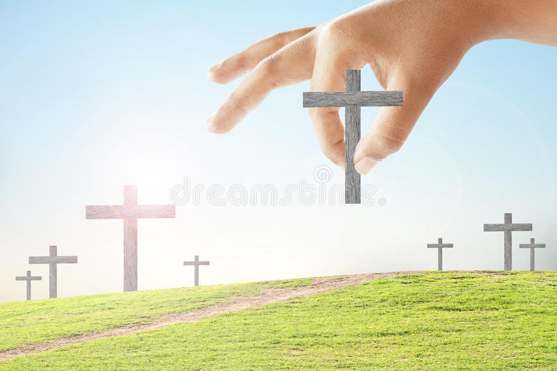 Hand took the cross stock images