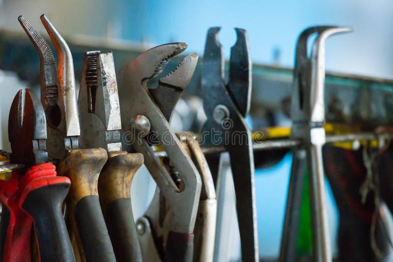 Hand tool pliers. Car workshop equipment. Tool on workbench stock photos