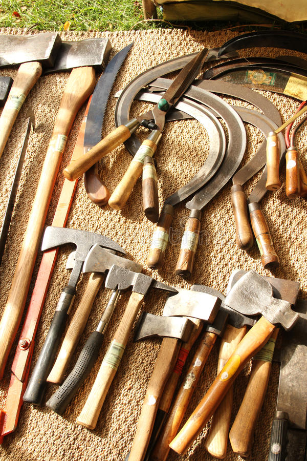 Hand tools on a textured cloth. Hand tools restored to work the land on a textured backdrop royalty free stock image