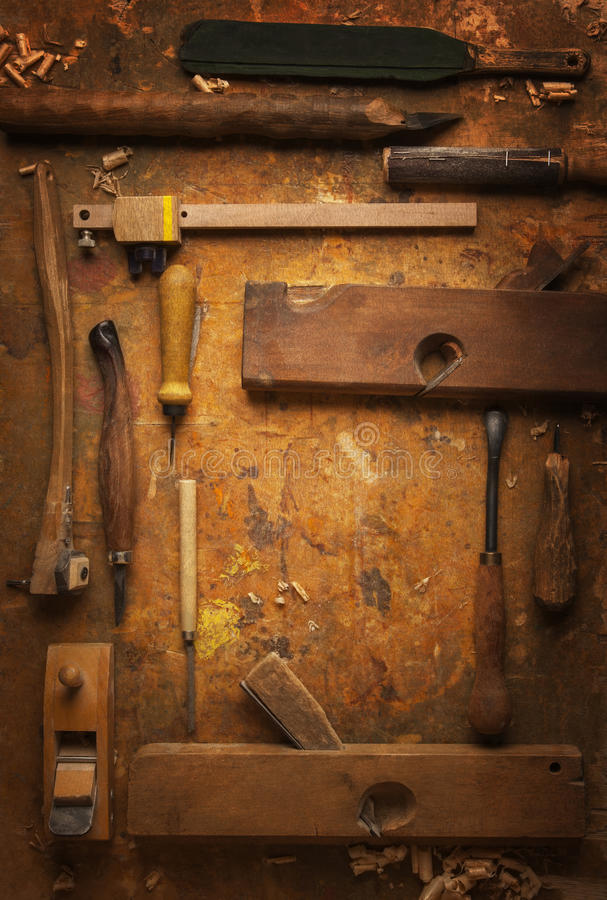 Hand tools Wood on an old wooden workbench. Hand tools Wood (Drill Jig Saw plane chisel) on an old wooden workbench royalty free stock images