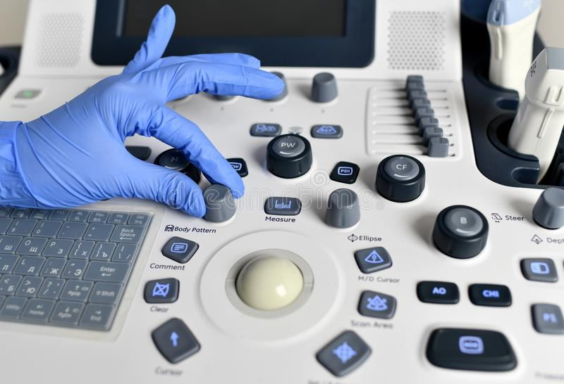 Hand touch button for medical device for ultrasound examination of the body for the purpose of diagnosis. In cabinet royalty free stock images
