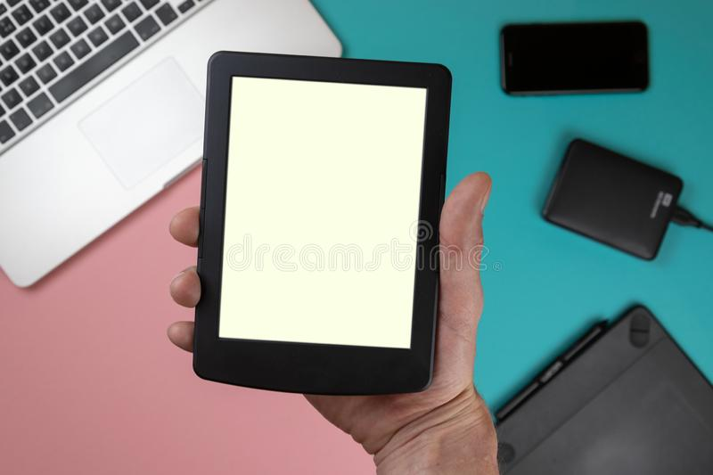 Hand touch on empty screen of tablet above colorful table top view, Leave space for display of your content, Technology concept, m stock image
