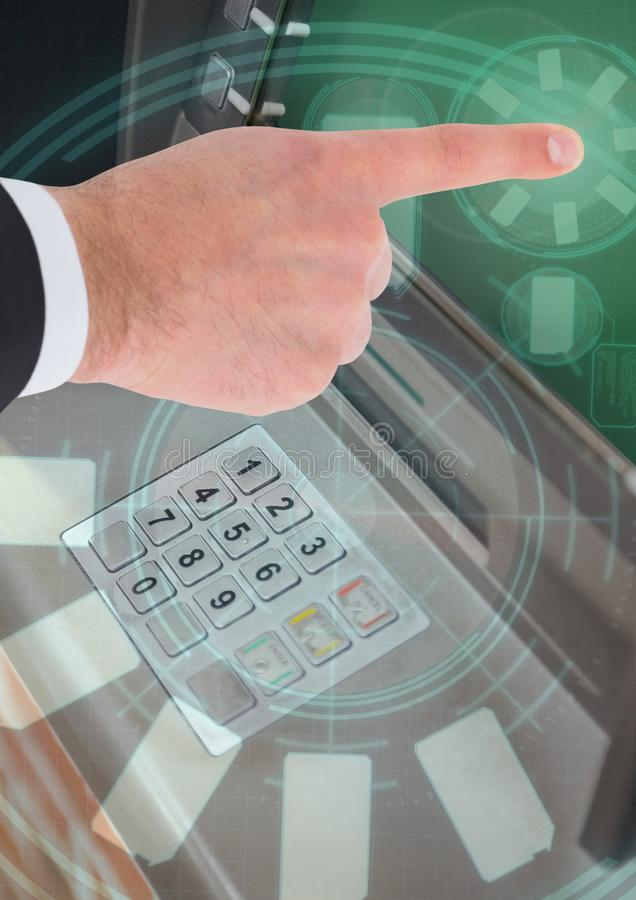 Hand touching bank ATM machine with interface graphics stock images