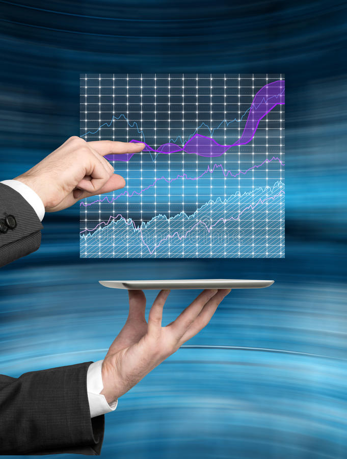 Hand touching chart. Hand touching stock chart ovet tablet stock photos