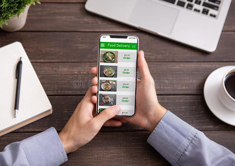 Hand touching phone screen for choosing food royalty free stock photo