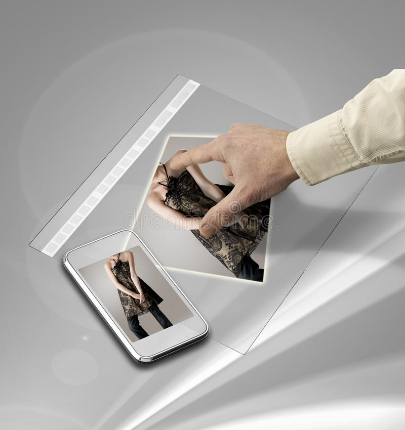 Hand touching screen on futuristic tablet. Closeup of hand touching screen on futuristic tablet royalty free stock image