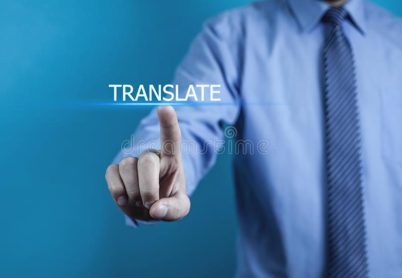 Hand touching on Translate word. Business concept royalty free stock images