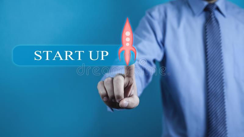 Hand touching transparent rocket icon. Startup concept stock image