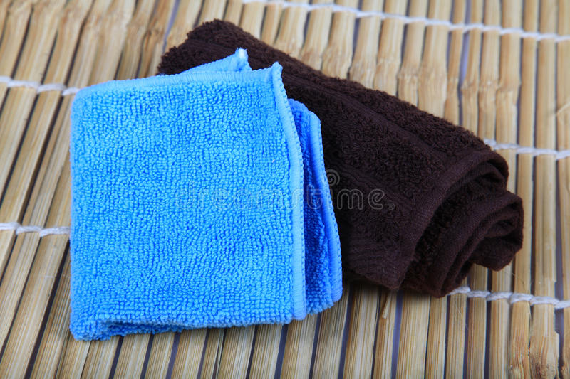 Hand towels. Two hand towels over wooden background stock photo