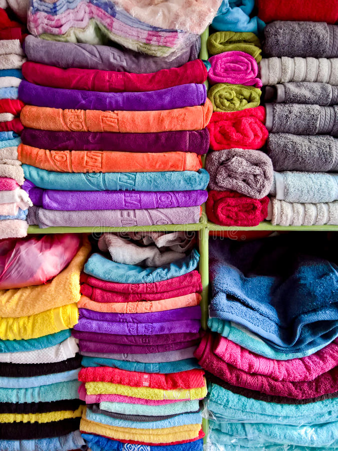 Hand Towels. Shelves full of colorful hand towels royalty free stock images