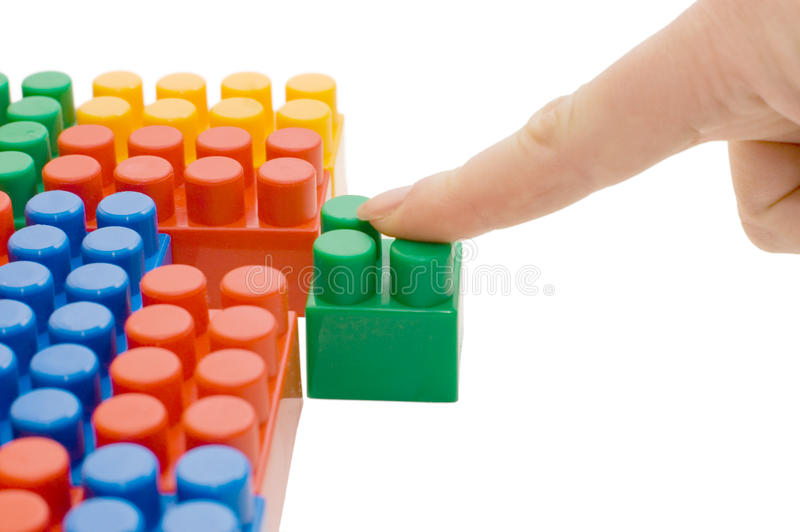 Hand with the toy block isolated. Over white royalty free stock photo