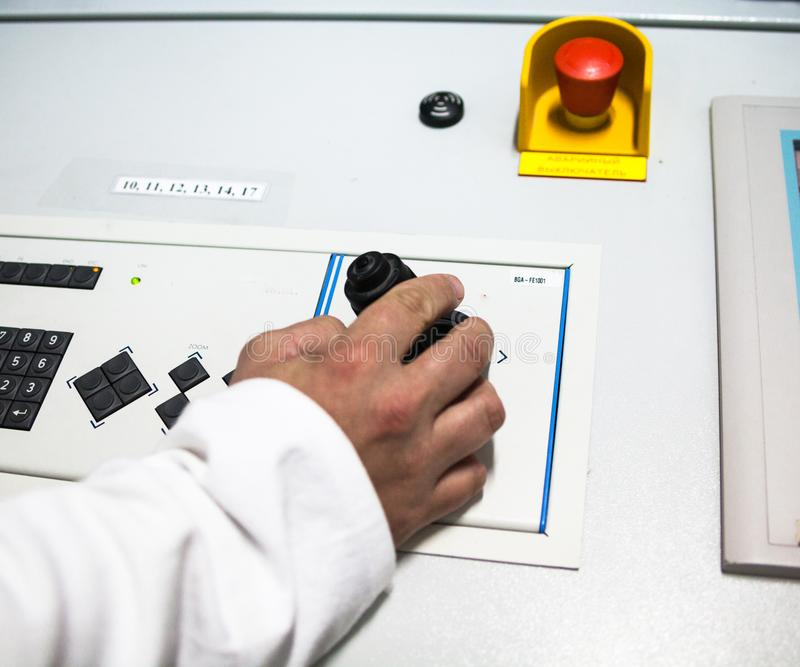 Hand turning the button on the control panel royalty free stock photography