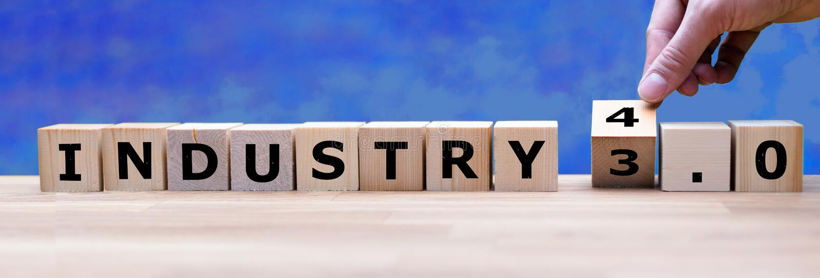 Hand is turning a dice. And changes the word `Industry 3.0` to `Industry 4.0 stock photo