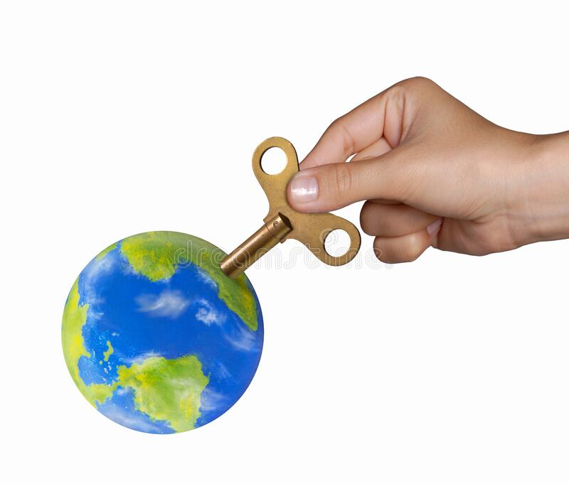 Hand turning mechanic handle to recharge the planet earth on powering planet concept. royalty free stock photography