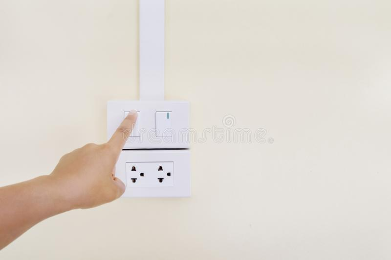 Hand turning on or off light. Switch stock photography