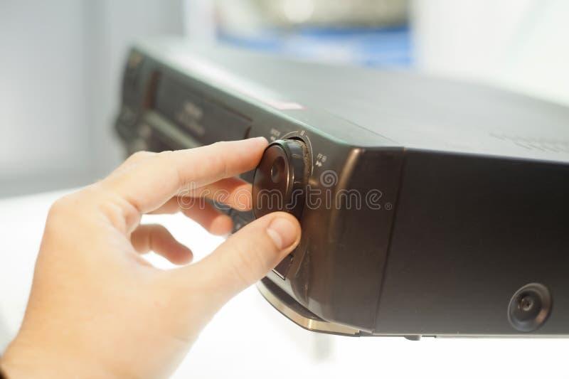 Hand turning volume knob up royalty free stock image