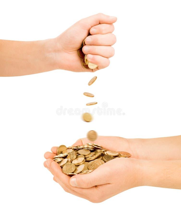 Hand twee met muntstukken stock afbeeldingen