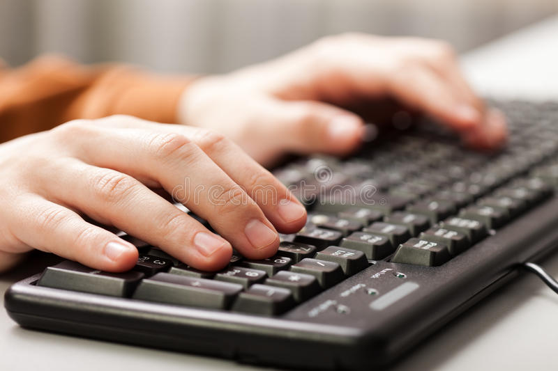 Hand typing computer keyboard. Business human hand working pc computer keyboard royalty free stock images