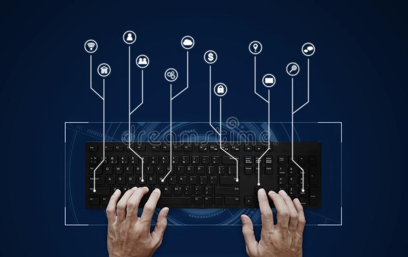 Hand typing on computer keyboard with application programming interface icon. S stock photo