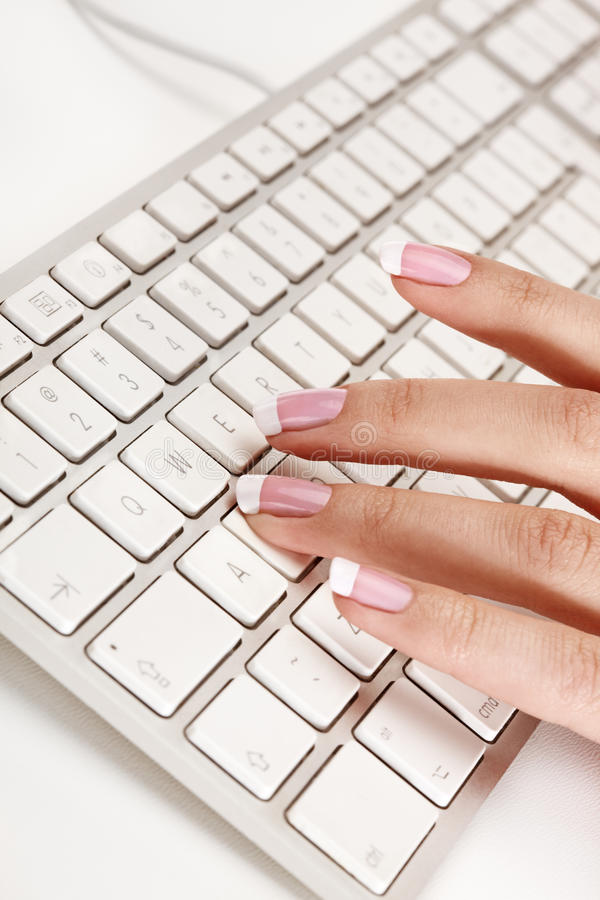 Hand typing on a keyboard royalty free stock photos