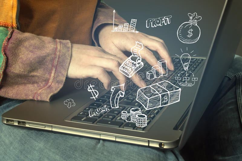 Hand typing on a laptop with business icons and symbols. Business, technology, internet and networking concept stock photo