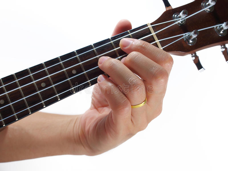 hand and ukulele stock photos