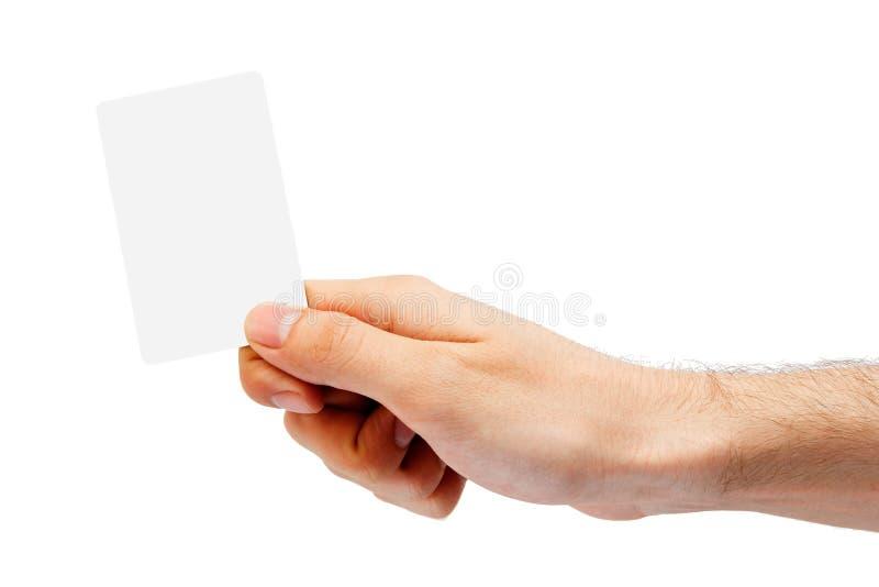 Hand und eine Plastikkarte stockfotos