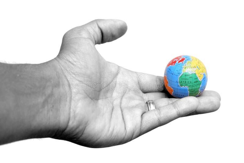 Hand und Erde lizenzfreie stockfotos